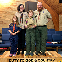 Emily volunteers with Cub Scouts and has served in a variety of roles over the years, including Den Leader and Committee Chair.