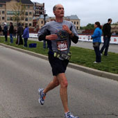 Ponder is an avid runner and has completed several marathons. Here he is approaching the finish line at the 2012 Carmel Marathon.
