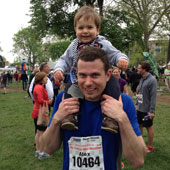 My husband, Alex, after completing the Indianapolis Mini-Marathon in 2013, sharing the medal with our son, Evan