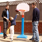 Three sons playing basketball.