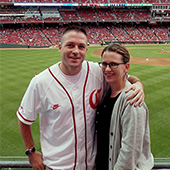 Robert and his wife, Amber, taking in a Reds game.