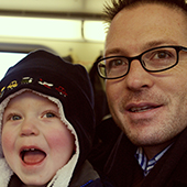 Robert with son, Eli, on the Virginia Railway Express Christmas train.